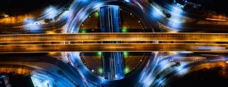 abstract time lapse birds eye view of highway overpasses at night